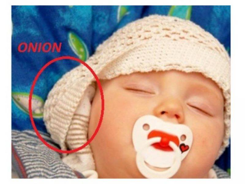 baby with onion