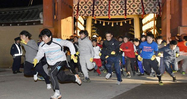 "Runners sprint toward the main hall of Nishinomiya Shrine in Nishinomiya, Hyogo Prefecture, western Japan,  in an annual race to pick a ""Fuku-otoko"" (lucky man)"